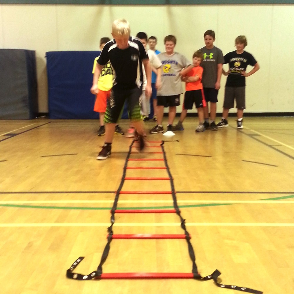 kids doing ladders at camp